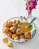 Fried dough balls with sauce