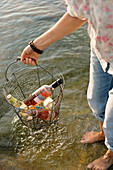 Chilled wine for a picnic by a lake