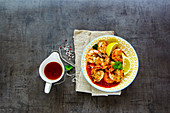 Delicious grilled pink Prawn Shrimp with lemons and sauce
