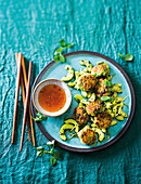 Salmon and pea fishcakes with cucumber stir-fry