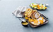 Gently cooked orange and leek pork loin with orange sauce