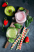 Green detox smoothie with apple and spinachs and pink smoothie with berries
