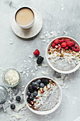 Chia pudding with coconut milk, berries, nuts, granola and coffee