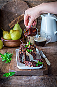 Chocolate and almond cake with poached pears