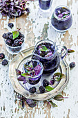 Lemonade with blackberries and purple basil