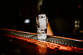 Vodka with ice cubes on a bar counter (The Grid Bar, Cologne, Germany)