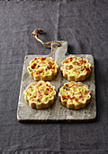 Mini ham and cheese tartlets with spring onions
