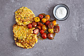 Sweetcorn fritters with braised tomatoes