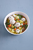 Vegetable stew with ricotta dumplings