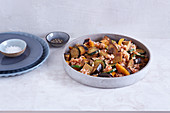Colourful vegetable paella with lupine fillets
