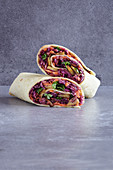 Vegan red cabbage coleslaw wraps with mango and lupine fillet