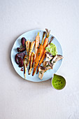 Oven-roasted vegetables with parsley hollandaise