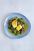 Fisch mit buntem Gemüse aus der Tajine