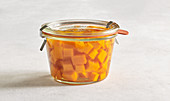 Sweet-and-sour pickled pumpkin in a preserving jar