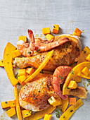 Chicken legs and prawns with oven-roasted pumpkin (seen from above)