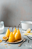 Poached pears with vanilla and lemon syrup