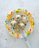 Vegetarian grain dumplings with a caper sauce