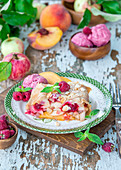 Fruit strudel with peaches, apples and raspberries