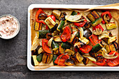 Colourful, oven-roasted with a goat's cream cheese dip (low carb)