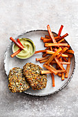 Escalope with a pumpkin seed coating and black salsify chips (low carb)
