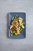 Stir-fried spicy rice noodles with chicken and bok choy