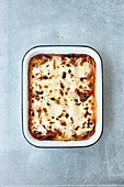 Gratinated ricotta and spinach cannelloni with tomato sauce