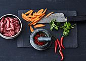 A stir-fry arrangement - meat, carrots, coriander and chilli