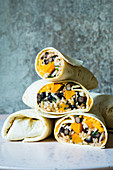 Mexican burritos with pumpkin, cheddar and black beans