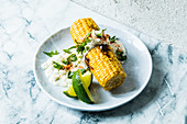 Grilled corn cobs with cream cheese