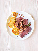 Saddle of venison with a nut crust and corn fritters (slow cooking)