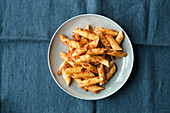 Penne with red autumnal pesto made from hazelnuts and tomatoes