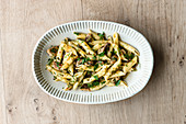 Penne with a herb and sardine sauce