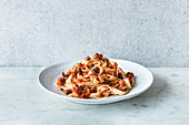 Tagliatelle with a bacon and tomato sauce