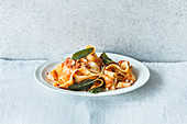 Pappardelle with a fruity, creamy tomato sauce and nuts
