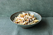 Penne with a creamy ham and mushroom sauce