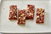 Redcurrant and nougat oil-sponge cake bars