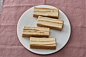 Slices of coffee cream oil-sponge cake
