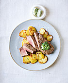 Rump steak with fried potatoes made in a hot-air fryer