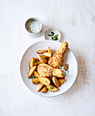 Chicken legs with potato wedges made in a hot-air fryer