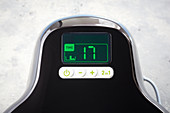 The timer on a hot-air fryer being set