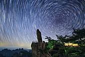 Star trails over Flying-Over Rock, time-exposure image