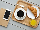 Breakfast tray and smartphone