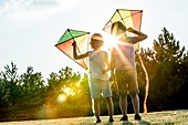 Boys holding kite