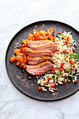 Pink sous vide duck breast with chutney and rice