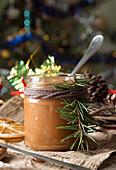 Jar of salt caramel and Christmas New Year decorations