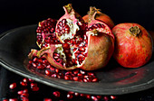 Pomegranate fruit is hiding beautiful red seeds inside its hard peel