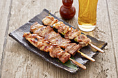 Yakitori skewers with a beer