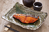 Teriyaki salmon served alongside Sake