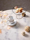 Espresso cups and mint biscuits on a wire stand