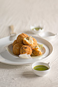 Fried stockfish and olive balls with parsley pesto